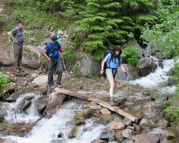 Hikers crossing stream