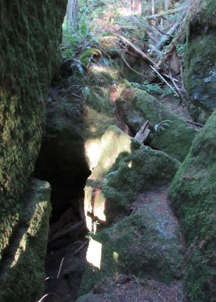 Large boulders and cave opening
