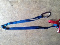 overhand or a figure-8 knot at the midpoint of the sling
