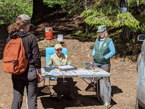 Kathy Weller and Zua Stivers speak with a hiker. Photo by Jim French..jpg