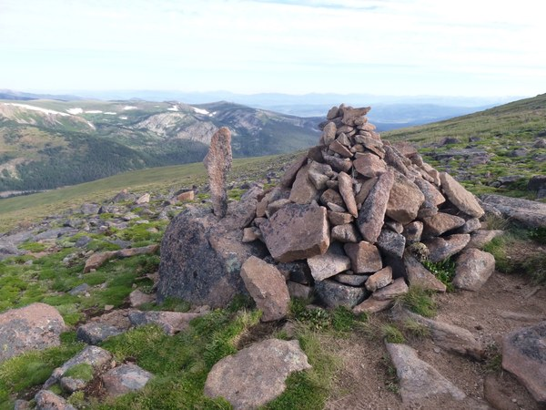 Rock cairn with mountains in background