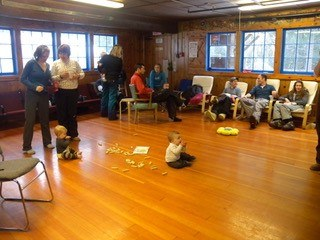 Main floor of Meany Lodge showing comfortable chairs with adults and kids enjoying themselves.